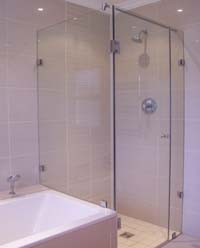 Frameless showers next to bath