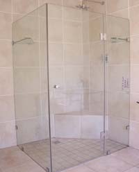 Custom frameless showers hinged door with panels